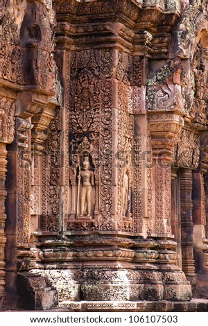 Detail Bas relief wall of Temple Banteay Srei in Angkor