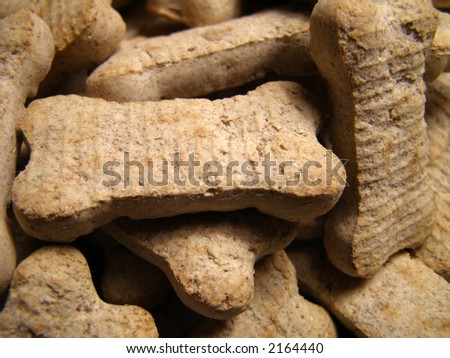 Detail close-up of dog cookies piled high. - stock photo
