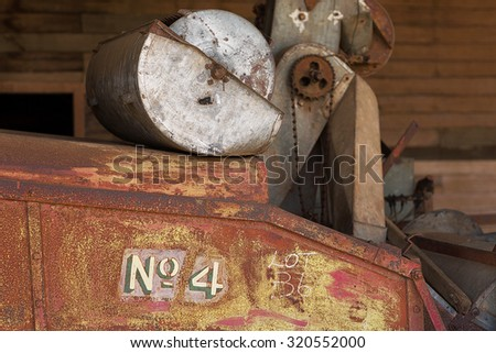 Detail close up of rusty old farm machinery - stock photo