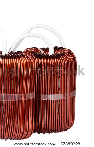 Detail Close-up View of two Large Industrial Toroidal Choke Coil isolated on White Background