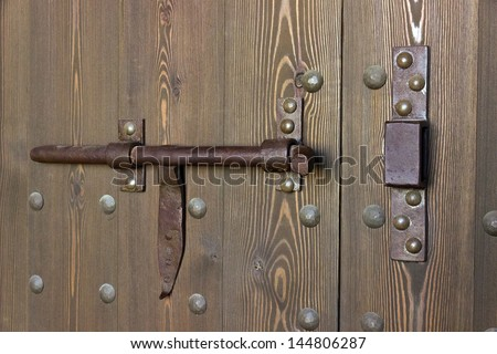 detail closed lock on an old wooden door
