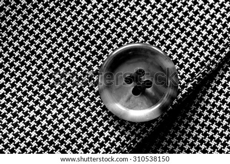 Detail closeup close-up of suit button hole fabric on sleeve of blazer jacket - stock photo
