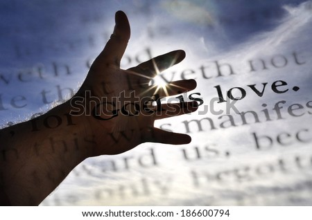 Detail closeup God is love scripture in bible verse - stock photo