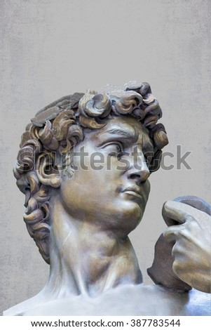 Detail closeup of Michelangelo's David statue on grunge background - stock photo
