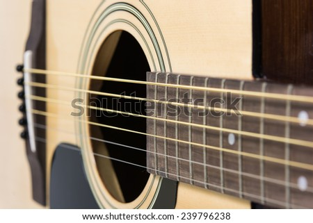 Detail closeup of wooden a classic guitar - stock photo