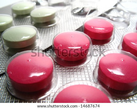 Detail drug pills, white and pink pills