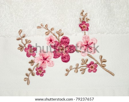 detail flower embroidery on white towel - stock photo