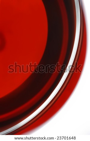 Detail from a red wine glass - stock photo