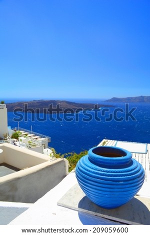 Detail from architectural style of Fira, Santorini with a view on a volcanic caldera and Kameni volcano in the distance