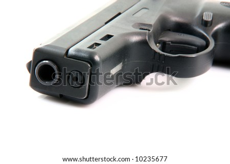 detail from handgun isolated on white background - stock photo