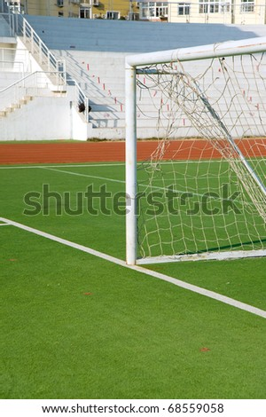 Detail from soccer pitch, goal on artificial grass
