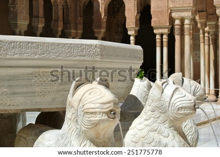 Detail from the famous Court of Lions in Alhambra palace, Granada, Andalusia - stock photo