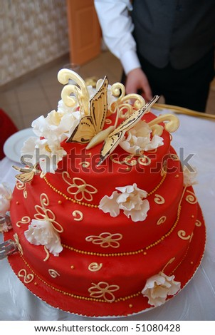 Detail from the groom and bride's red cake on the wedding table