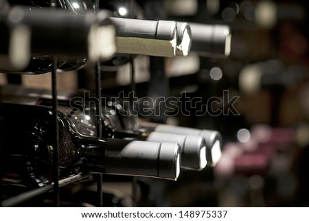 Detail from wine cellar with resting bottles