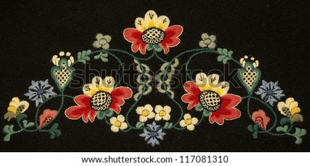 Detail from 100 years old Norwegian bunad embroidery - stock photo