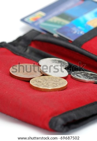 Detail image of red wallet with cards and coin.