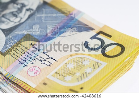 Detail image showing stack of Australian fifty dollar bills isolated on white - stock photo