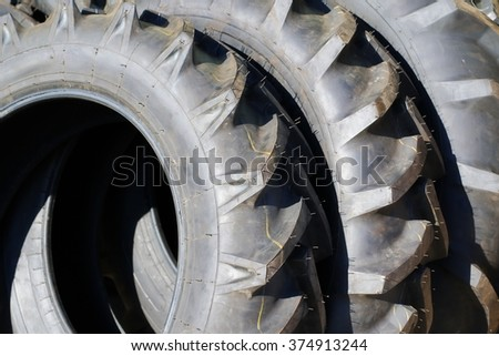 detail new tractor rubber tire - stock photo