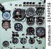 Detail of a airplane cockpit with various indicators and buttons - stock photo