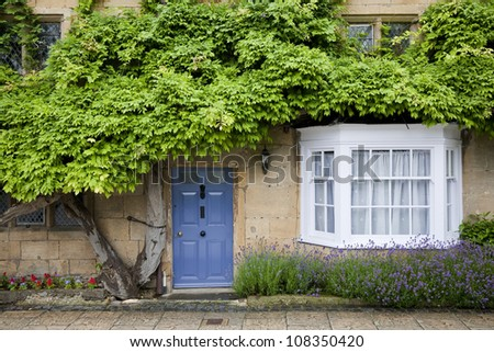 Detail of a beautiful picturesque cottage facade in the village of Chipping Campden, Cotswold, United Kingdom. - stock photo