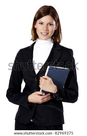 Detail of a beautiful young businesswoman holding a notebook