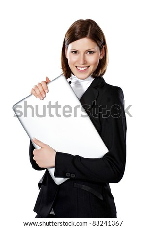 Detail of a beautiful young businesswoman holding laptop both hands