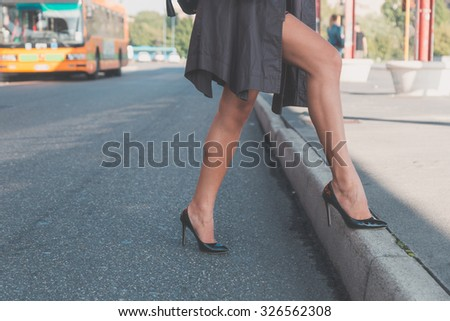 Detail of a beautiful young woman with skirt posing in an urban context - stock photo