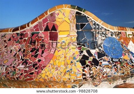 Detail of a bench by architect Gaudi, tile background in Park Guell in Barcelona Spain - stock photo