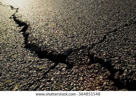 Detail of a big crack in an asphalt  - stock photo