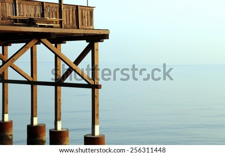 detail of a big wooden stilt house on the seashore - stock photo