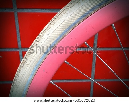 detail of a bike wheel with red tiles