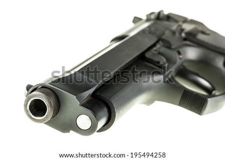 detail of a black 9mm pistol barrel isolated over a white background - stock photo