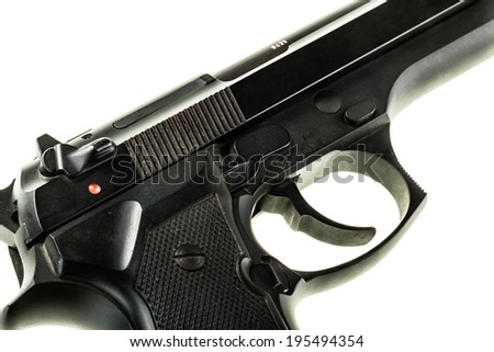 detail of a black 9mm pistol isolated over a white background - stock photo