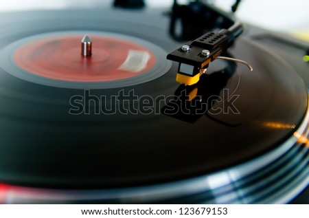 Detail of a black turntable in motion.