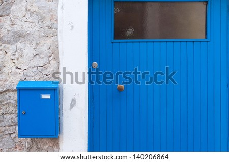 Detail of a blue mediterranean door with letterbox - stock photo