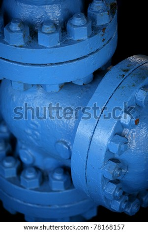 Detail of a blue pipe with screws - stock photo