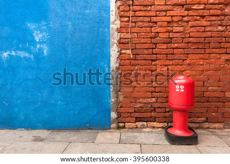 Detail of a blue wall with hydrant from Burano island, Venice