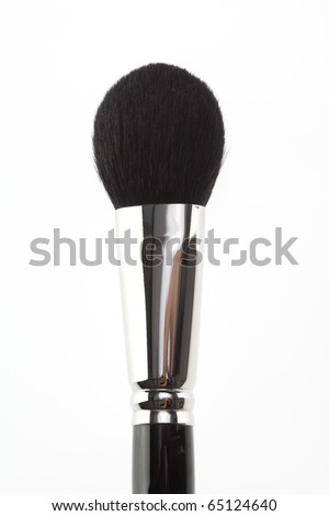 detail of a blush brush, shot on white background, in a vertical position. - stock photo