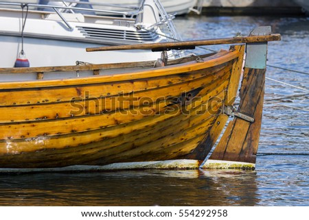 detail of a boat in the port of Lillesand in Norway