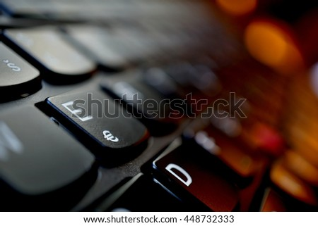 Detail of a brand new modern black laptop keyboard with the focus on the key with Euro currency(â?¬) symbol