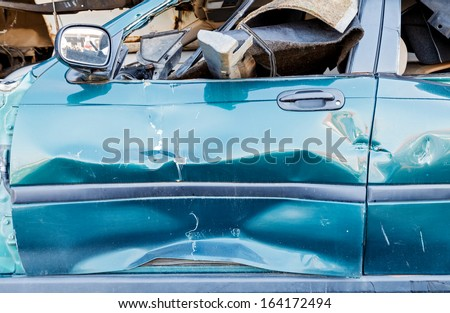Detail of a broken car in a junkyard - stock photo