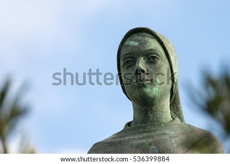 Detail of a bronze statue of the Virgin Mary in Portofino village, Genova, Liguria, Italy