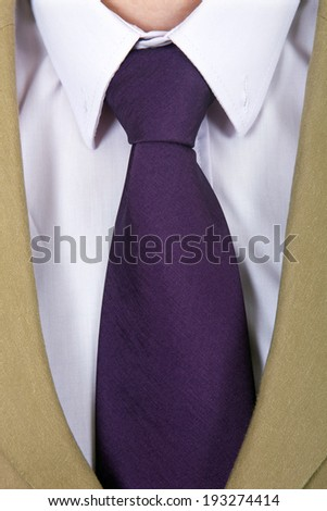 detail of a Business man Suit with purple tie - stock photo