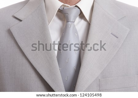 detail of a Business man Suit with silver tie - stock photo