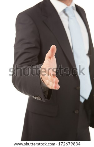 Detail of a business man with an open hand ready to seal a deal. Closeup.  - stock photo