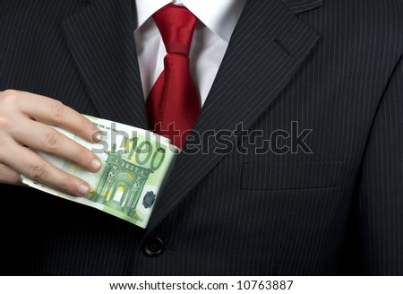 Detail of a businessman hand with money - stock photo