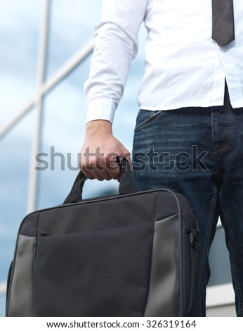Detail of a businessman holding a briefcase