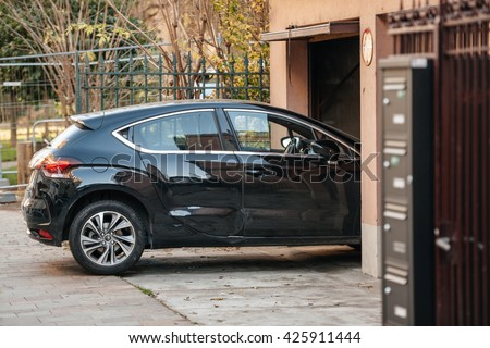 Detail of a car entering through garage door