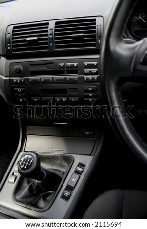 Detail of a car's interior - gear shift in focus