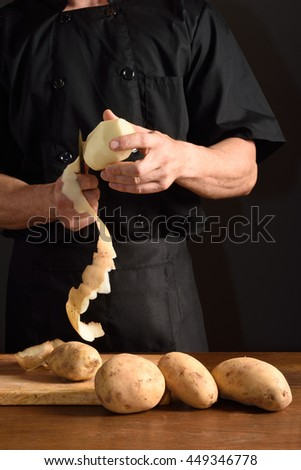 detail of a chef slicing potatoes - stock photo